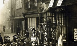 Sylivia Pankhurst addressing a crowd outside the headquarters of the East London Federation of Suffragettes, Old Ford Road, Bow.